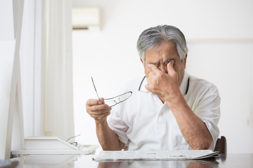 senior man with eye pain